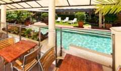 Cairns accommodation - Enjoy complimentary continental breakfast by the Poolside Restaurant at Cairns Queens Court Hotel