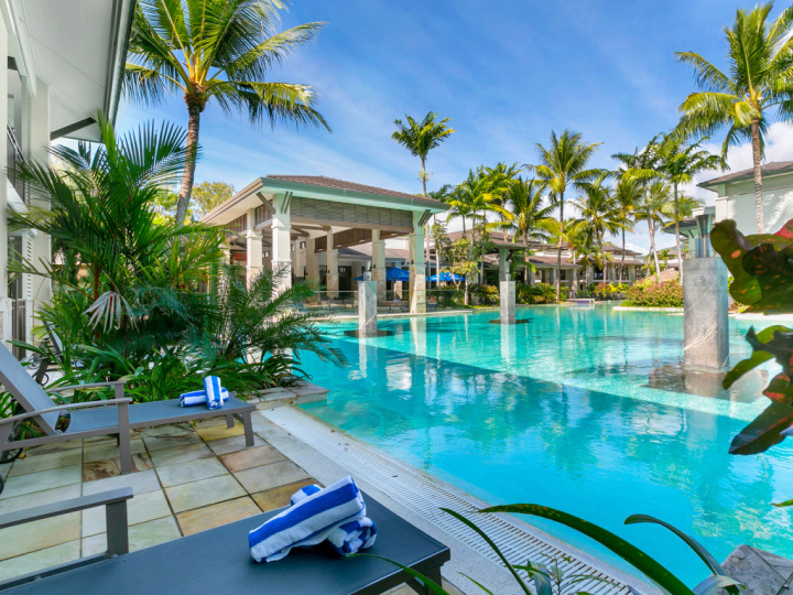 Enjoy direct lagoon pool access from your Swim Out Holiday Apartment within Sea Temple Resort Port Douglas