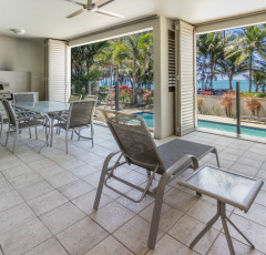 Enjoy looking out over the swimming pool to Palm Cove Beach