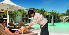 Enjoy poolside service at Sea Temple Port Douglas
