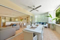 Enjoy spacious living and large outdoor balcony at Cayman Villas Port Douglas