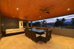 Enjoy the tropical lifestyle on the holiday homes balcony with views over Port Douglas