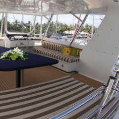 Enjoy the ocean breeze from the fly bridge on the luxury yacht | Great Barrier Reef Australia
