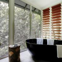 Enjoy the rainforest from your luxurious soaker bath tub on the balcony | Rainforest Bayan at Daintree Eco Lodge