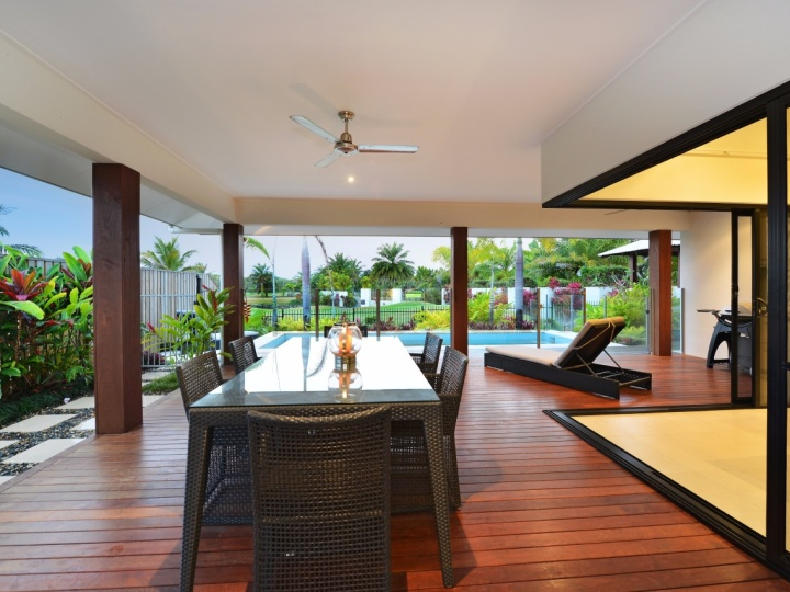 Enjoy the spacious open plan living, timber deck overlooking your private Swimming Pool and golf course views beyond.