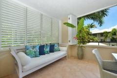 Enjoy the tropical lifestyle as you relax on the outdoor daybed at Cayman Villas Port Douglas