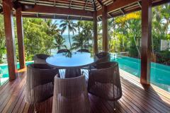 Enjoy the tropical lifestyle in this luxury Beachfront Holiday Home in prime location at Port Douglas - complete with Private Beach and Private Swimming Pool
