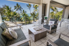 Enjoy the tropical lifestyle with spacious balcony overlooking Palm Cove beach - Island Views Holiday Apartments Palm Cove