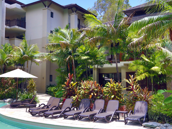 Enjoy the tropical sunshine by the resort pool | Sea Temple Private Apartments Palm Cove
