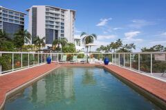 Enjoy the tropical sunshine from the elevated Swimming Pool overlooking Cairns Esplanade | Cairns Holiday Apartments