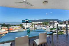 Enjoy tropical living with dining alfresco as you overlook Cairns out to the Ocean  - Cairns Holiday Apartment style accommodation
