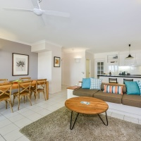 Enjoy views of Palm Cove beach from the open plan living and balcony - Palm Cove Private Apartment within Alamanda