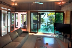 Enjoy views out over your private swimming pool and to the ocean from your living area - Port Douglas Luxury Holiday Home