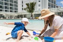 Families will love the man made beach at the lagoon pool -  Riley a Crystalbrook Collection Resort Cairns