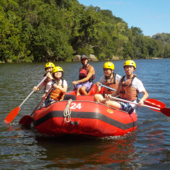 A Family Enjoying White Water Rafting On The Barron River From Northern Beaches