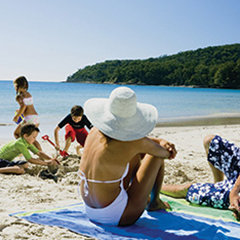 Cairns & Port Douglas Best Tours & Attractions- Family on the beach