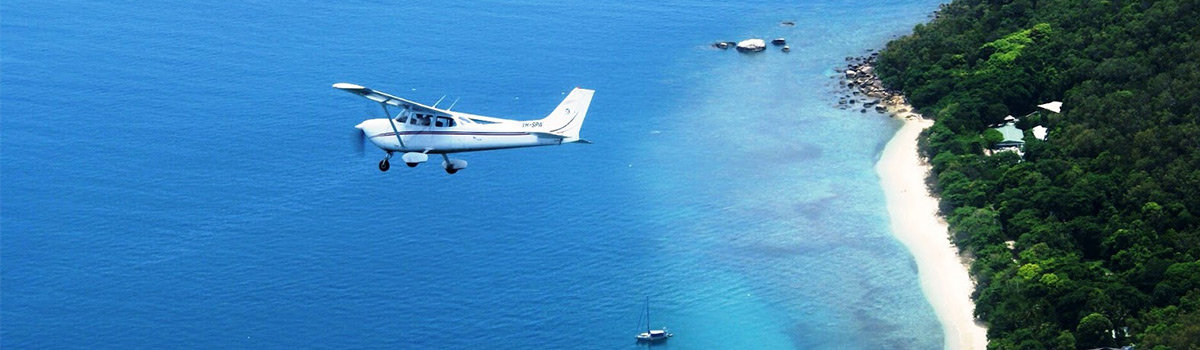 Cairns Scenic Flights - Fixed Wing Scenic Airplane flights over the Great Barrier Reef in Cairns