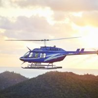 Fly above the rainforests and the Great Barrier Reef in a helicopter from Cairns Queensland Australia