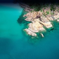 Fly to exotic locations by helicopter for a private picnic on a deserted beach or a waterfall on the Great Barrier Reef