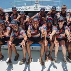 Friendly crew onboard the Great Barrier Reef tour in Cairns