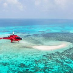 From Cairns your helicopter flies over sand cays and islands on the Great Barrier Reef