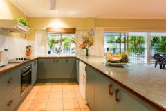Fully Self Contained Kitchen overlooking Pool and Living areas - Palm Cove Holiday Home