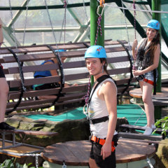 Getting ready and strapped in to zip line across ferocious wild animals in the Wildlife Dome in Cairns