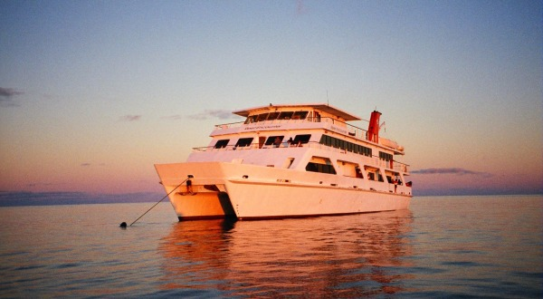 Cairns Dive Tours - Sunrise on the Great Barrier Reef - Liveaboard Dive boat at Sunrise