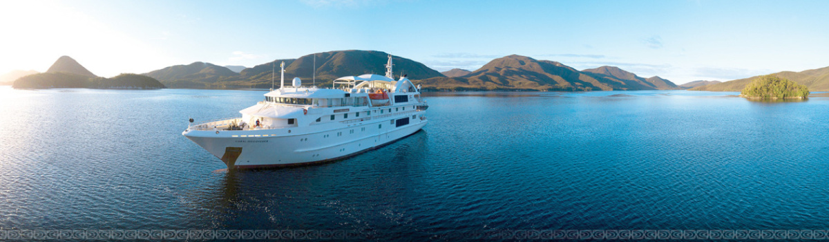 Great Barrier Reef Cruises Queensland Australia - Small luxury cruise ship at anchor on the reef