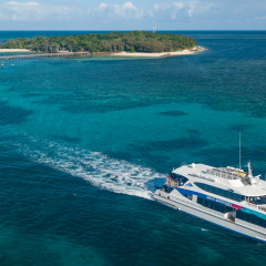 Great Barrier Reef tour boat leaving Green Island to return to Cairns