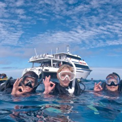 Happy scuba divers Pro Dive Cairns