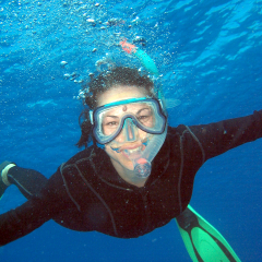 Happy snorkeller on the outer Great Barrier Reef from Cairns in Queensland Australia