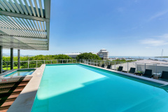 Roof top Swimming Pool with Cairns City Views | Cairns Private Apartment in Harbour Lights Complex