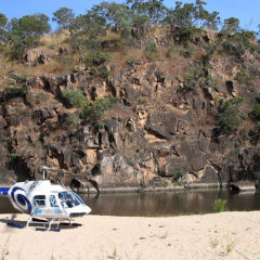 Helicopter at remote water hole in Tropical North Queensland