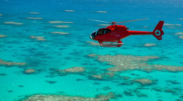 Helicopter Flying Above Great Barrier Reef in Cairns