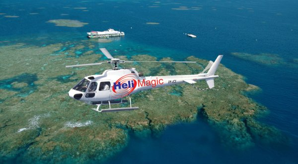 Helicopter flying over the Great Barrier Reef in Cairns