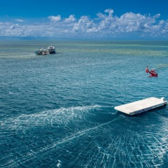 Helicopter landing on the pontoon out on the Great Barrier Reef off Cairns