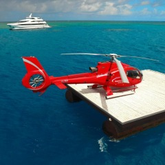 Helicopter meeting the luxury boat on the Great Barrier Reef