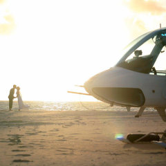 Helicopter on a remote sand cay on the Great Barrier Reef - Marriage Proposal