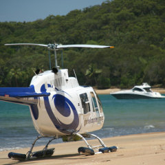 Helicopter on remote beach on the Great Barrier Reef