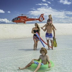 Helicopter scenic flight to private sand cay in the middle of the Great Barrier Reef in Australia