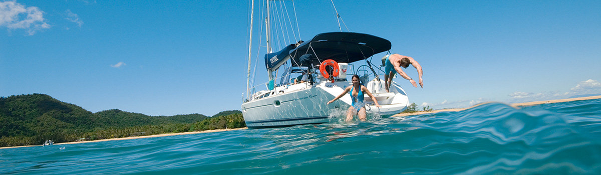Cairns Tours Package Deals - Port Douglas private charter boat with divers on the Great Barrier Reef
