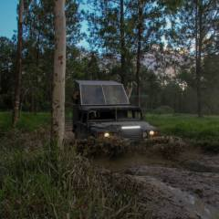 Hummer Going Through Mud | Cairns Tour