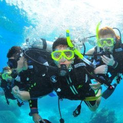 Introductory Scuba Diver with dive master on the Great Barrier Reef in Australia