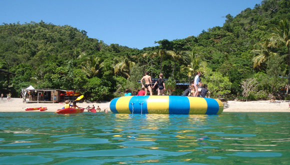 Jump on the in water trampoline on Fitzroy Island on the Great Barrier Reef