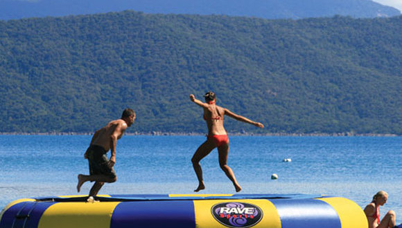 Jump on the in-water trampoline on Fitzroy Island on the Great Barrier Reef
