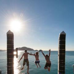 Jumping for joy on Fitzroy Island on the Great Barrier Reef in Australia