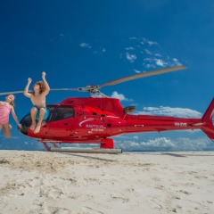 Kids are excited to be flying in a helicopter and landing on a sand cay to snorkel