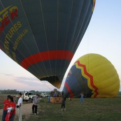 Landing  in a field on a hot air balloon from Cairns