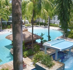 Large Lagoon Swimming Pool with Swim Up Bar, Formal Pool (Heated in Winter) & Spa with Waterfall - Beach Club Private Apartments, Palm Cove